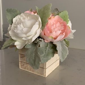 Artificial flower arrangement in wooden box